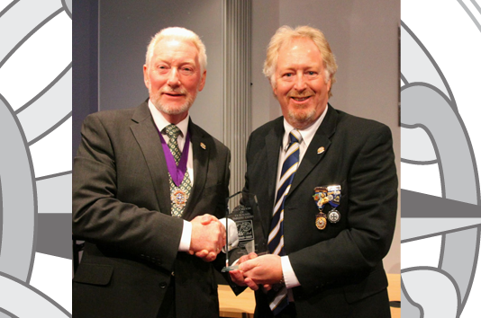41 Club - Simon Thomas receiving an award from Terry Cooper, National President, at the Harrogate AGM 2015 for personal contributions to the 41 Club website project